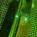 Featured image: A laser treats the surface of copper, giving it a texture that would allow the metal to instantly kill bacteria. (Purdue University/Erin Easterling)