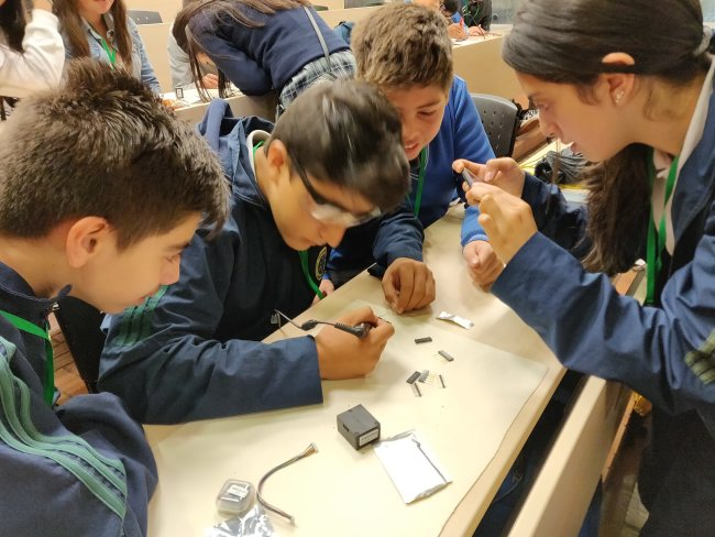 This is an image of a group of students working on a sensor.