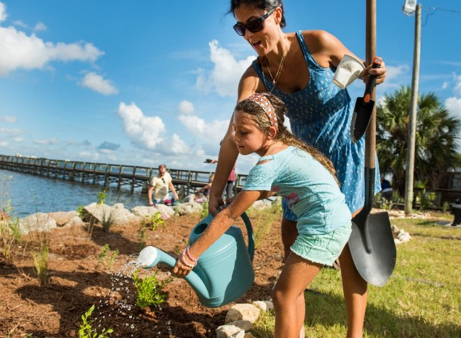"""To help improve water quality along the coast, Surfrider volunteers also help plant """"ocean-friendly"""" gardens upstream, which can help stop pollutants from reaching the water. (Credit: Kilby Photo LLC/Courtesy of Surfrider)"""